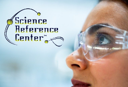 Woman with safety glasses on  captioned Science Reference Center