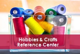 Spools of different colored thread in a glass bowl captioned Hobbies & Crafts Reference Center